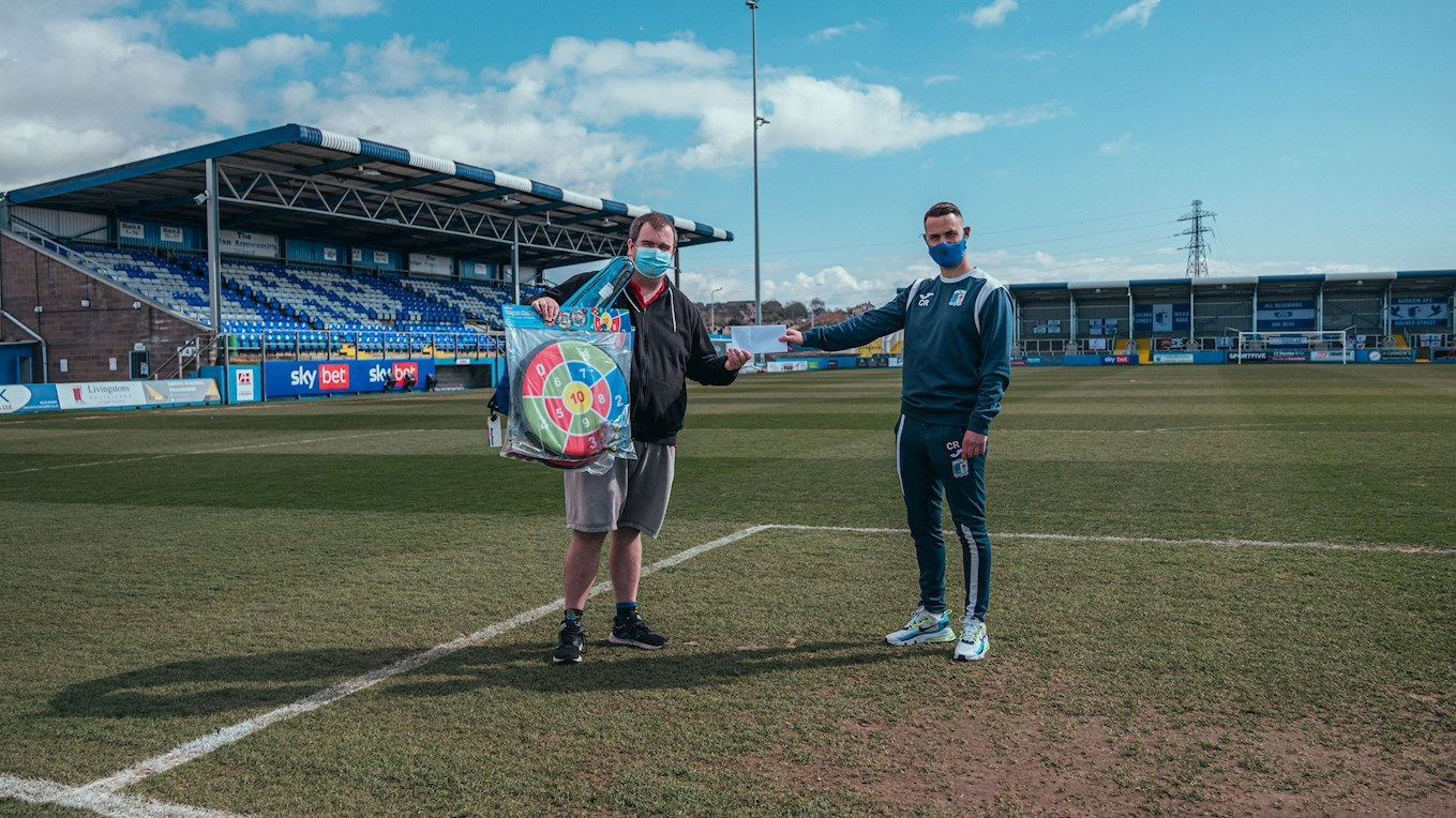 A photograph of Jeff Holt and Craig Rutherford on the pitch at Barrow