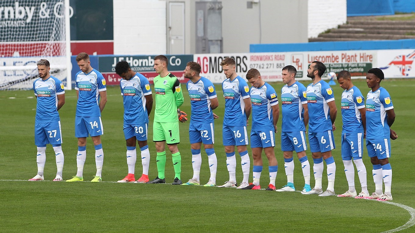 A photo of the players observing a minute's silence