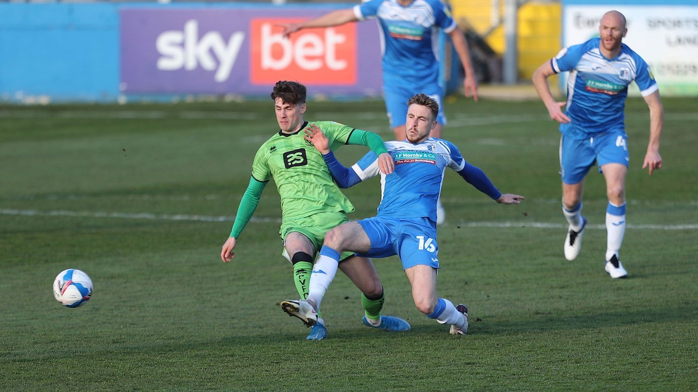 A photograph of Tom Beadling in action against Port Vale