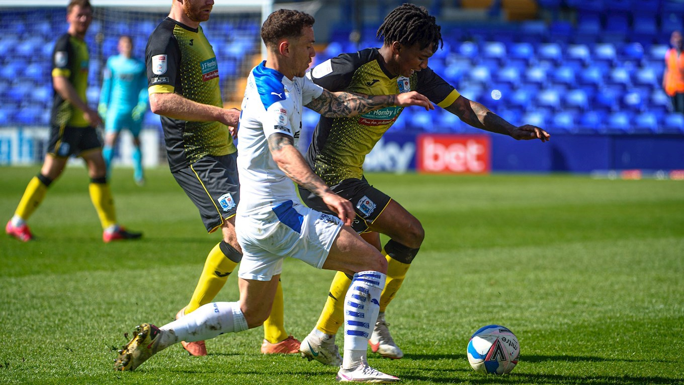 A photograph of Kgose Ntlhe in action for Barrow at Tranmere Rovers