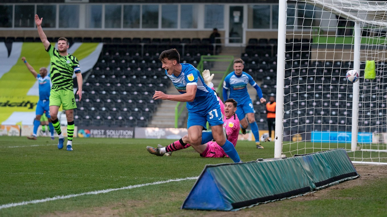 A photograph of Bobby Thomas celebrating scoring for Barrow at Forest Green Rovers